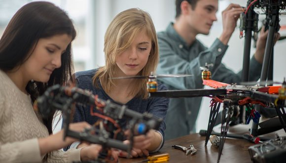 Female students building a drone.