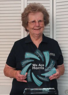 Beverly Carraher holding the We Are Harris award.