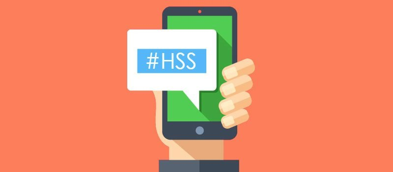Vector of hand holding smartphone with speech box showing #HSS