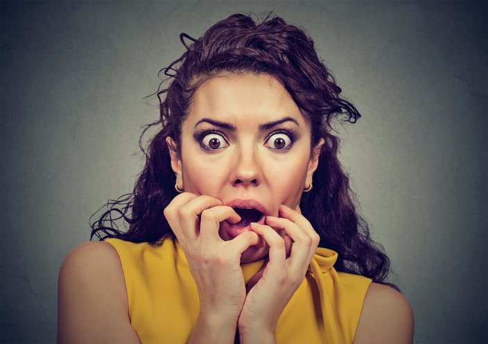 Woman with scared expression on her face.