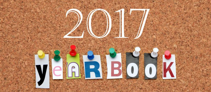 Corkboard with YEARBOOK pinned beneath 2017