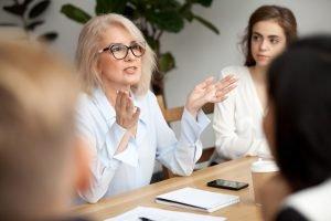 Experienced teacher explaining concept to younger teachers.