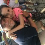 Roma child with volunteer