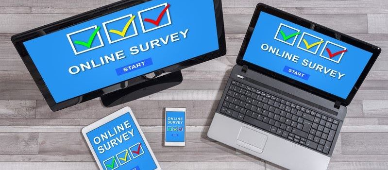 various devices with survey software on screen