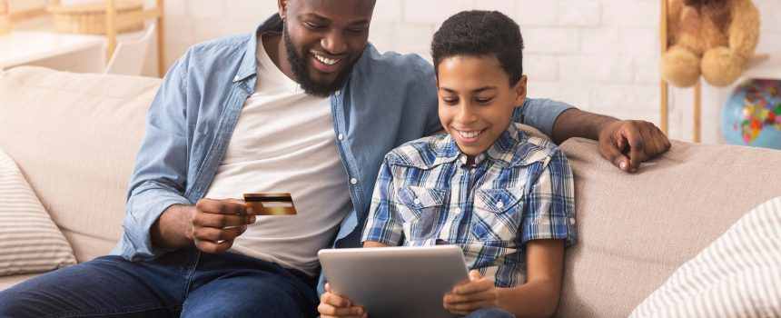 father and son at home ordering and paying online