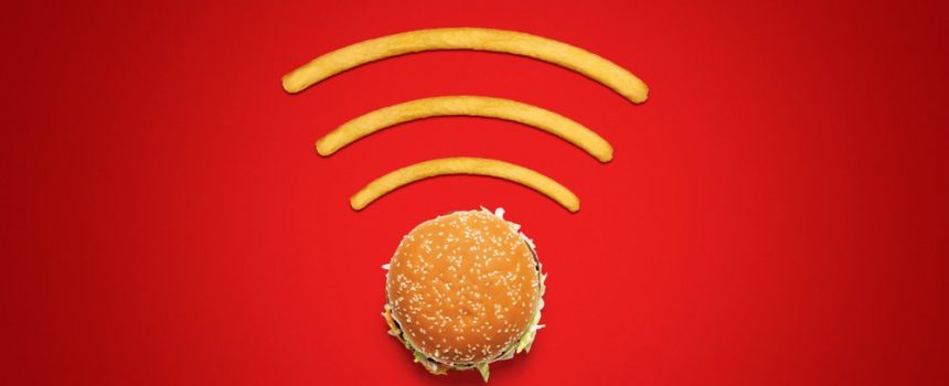 hamburger and french fries laid out like wifi symbol, on red background